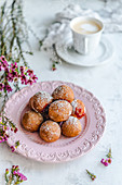 Mini donuts filled with rose jam, sprinkled with powdered sugar