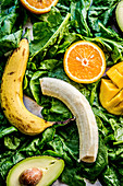 Bananas, oranges, mango, avocados and spinach for a smoothie