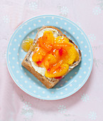 Peach and orange marmalade on a slice of white bread
