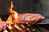 Hamburger patty on barbecue grill