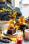 Autumn chocolate cake with cranberry. A moment of relaxation, candles, warm sweaters and autumn leaves