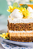 Close-up on layers of carrot cake with cream