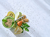 Healthy green smoothie with ingredients