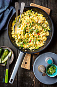 Scrambled eggs with potatoes and pepper