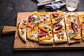 Vegan tarte flambée with pumpkin, figs and smoked tofu