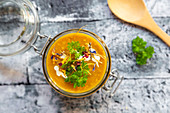 Pumpkin soup with lupine meal (minced meat substitute), parsley and dried edible flowers