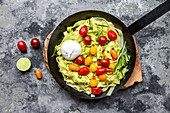 Fettuccine with avocado pesto, tomatoes, chili, burrata and rosemary