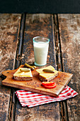 Peasant breakfast with cheese, bread, gherkins and a glass of milk