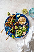 Balinese minced pork satay with quick pickled cucumber salad and satay sauce