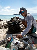 Collecting plastic waste on a beach,Indonesia