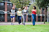 Group of adults jogging in the park
