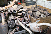 Pile of catalytic converters at a metal recycling centre