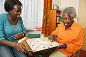 Daughter and mother playing scrabble