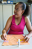 Teenage girl with learning disability in an art class