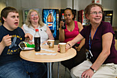 Students with learning disabilities and staff taking a break