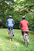 Woman and teenager out in the countryside cycling