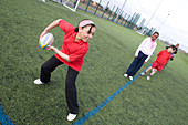 Group of children practicing rugby