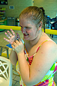 Woman with learning disability at swimming pool