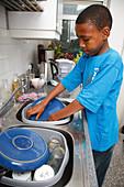 Teenager washing up