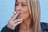 Portrait of white woman smoking