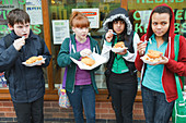 Teenagers eating fish and chips