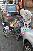 Mother with twins in buggy trying to cross road