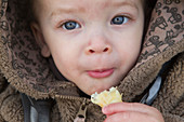 Toddler eating a chip