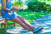Close-up of a woman reading in a park