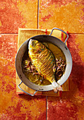 Turmeric bream with onions