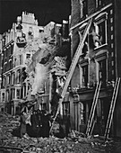 Rescue men at work, searching, helping to safety, 1941