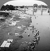Dbobies washing clothes in the Goomti River, India, 1900s