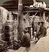 Workmen watching kilns of Awata porcelain, Japan, 1904