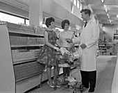 Supermarket shoppers and salesman, 1961
