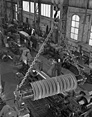 A busy foundry shop floor with lathes, 1963