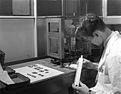 Lab technician with a slide rule, 1962