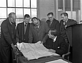 A group of foundry staff with technical drawings, 1963