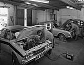 Cortina Mk 2 and Mk3 GT in a garage, 1972