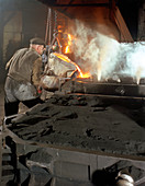 Pouring molten metal from a cupola into moulds, 1965