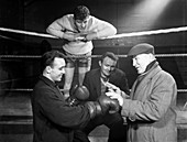 A miner gets some ringside boxing advise, Newcastle, 1964