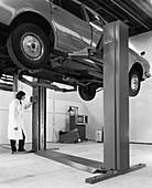 A Ford Zodiac on a Laycock asymmetric lift, 1972