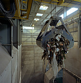 Waste ready for incineration in giant crane grab jaws, 1980
