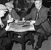 A game of dominoes in a miners' welfare club, 1963