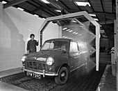 Mini van being washed in a car wash, 1965
