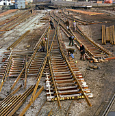 Engineers fabricating a rail junction, 1977