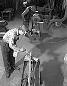 Steel bars being cut to size at J Beardshaw & Sons, 1963