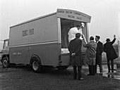 Traders buying from a Danish Bacon wholesale van, 1961