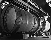 Rotary kiln section being welded, 1962