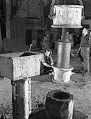 Stripping a steel casting, South Yorkshire, 1963