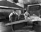 Heat treating a two metre saw blade, 1963