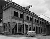 Minibus parked on a building site, 1964